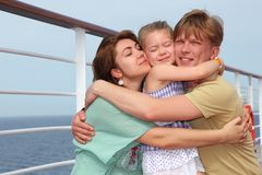 Family on cruise liner deck embracing each other Royalty Free Stock Photos