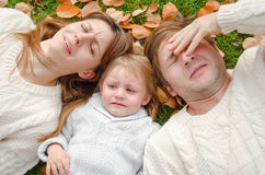 Family crying outdoors in autumn. Day Royalty Free Stock Photo
