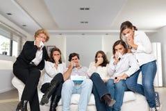 Family crying on the sofa Stock Photo