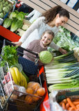 Family customers buying ripe fruits Royalty Free Stock Photography