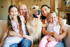 Family with cute pet Stock Photos