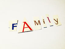 Family - Cutout Words Collage Of Mixed Magazine Letters with White Background. Caption composed with letters torn from magazines with White Background Stock Image