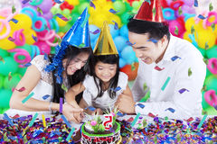 Family cutting a birthday cake Stock Photography