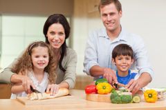 Family cutting ingredients Stock Photo