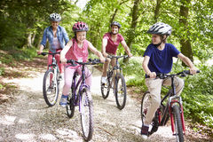 Family On Cycle Ride In Countryside Royalty Free Stock Images