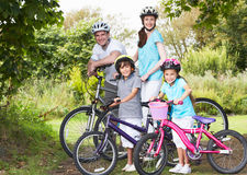 Family On Cycle Ride In Countryside Royalty Free Stock Photography