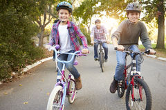 Family On Cycle Ride In Countryside Royalty Free Stock Image
