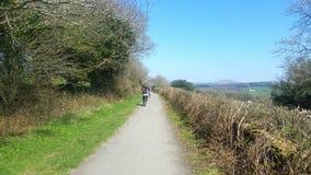 Family cycling along a dartmoor cycle path Royalty Free Stock Image
