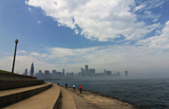 Family Cycling along Lake Michigan and Chicago Skyline Stock Photos