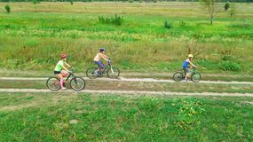 Family cycling on bikes outdoors aerial view from above, happy active mother with children have fun, family sport. And fitness Royalty Free Stock Images