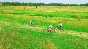 Family cycling on bikes outdoors aerial view from above, happy active mother with children have fun Royalty Free Stock Image