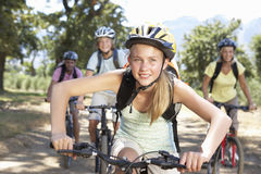 Family Cycling Through Countryside Royalty Free Stock Images