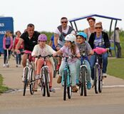 Family cycling day out group outdoor exercise