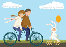 Family Cycling: Father, Mother and Child. In Rabbit Costumes Stock Illustration