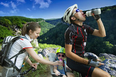 Family cycling holiday in the mountains Royalty Free Stock Photography