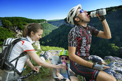 Family cycling holiday in the mountains Royalty Free Stock Image