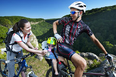 Family cycling holiday in the mountains Stock Photography