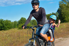 Family cycling outdoors Stock Photos