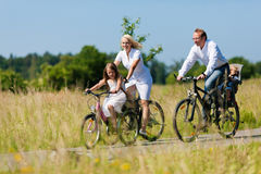 Family cycling outdoors in summer Royalty Free Stock Image