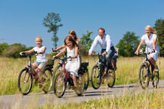 Family cycling outdoors in summer Stock Images