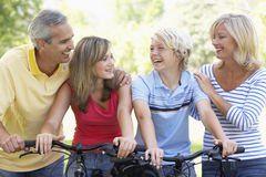 Family Cycling Through A Park Royalty Free Stock Image