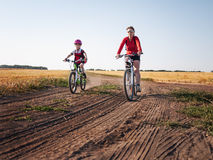 Family cycling in summer Stock Image