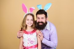 Family dad and daughter wear bunny ears. Father and child celebrate easter. Spring holiday. Easter day. Easter. Activities for children. Happy easter. Holiday stock photo