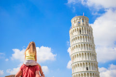 Family of dad and kid background the Learning Tower in Pisa. Pisa - travel to famous places in Europe. Stock Images