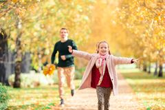 Family of dad and kid on beautiful autumn day in the park stock photos