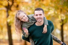 Family of dad and kid on beautiful autumn day in the park stock photo