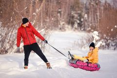 Family of dad and kids vacation on Christmas eve outdoors stock photo