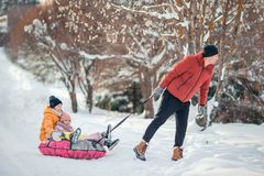 Family of dad and kids vacation on Christmas eve outdoors royalty free stock photo
