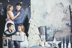 Family, dad, mom and kids happy with beautiful smiles to celebrate Christmas Royalty Free Stock Photo