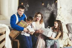 Family, dad, mom and kids happy with beautiful smiles to celebrate Christmas Stock Photos