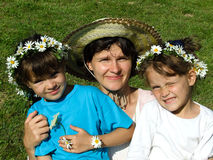 Family with daisy chains Stock Photo