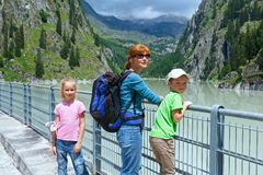 Family on dam ( Switzerland) Stock Images