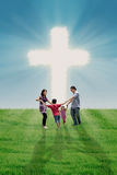 Family dance at the Cross. Happy family is dancing at the bright cross outdoor Royalty Free Stock Photography