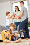 Family dancing and making music Stock Photography