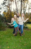 Family Dancing during a nice Autumn Day in the park Royalty Free Stock Photography