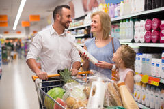 Family with daughter buying shampoo Stock Photos