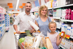 Family with daughter choosing shampoo Stock Photo
