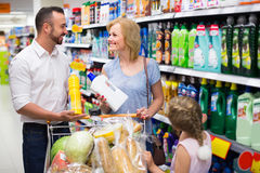 Family with daughter in household department Stock Photography
