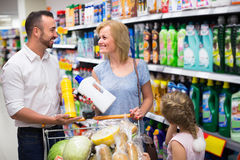 Family with daughter in household department Royalty Free Stock Photo