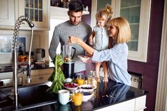 Family with daughter preparing meal stock photography