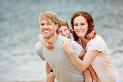 Family with daughter on summer vacation Stock Images