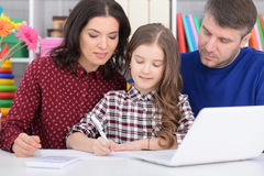 Family with a daughter using a laptop. Portrait of a family with a daughter using a laptop Royalty Free Stock Photo