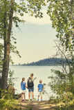 Family on a day hike together near a beautiful mountain lake Stock Image