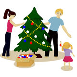 Family decorate Christmas tree Stock Photography