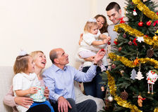 Family with decorated Christmas tree Royalty Free Stock Image