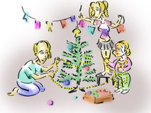 Family decorates the Christmas tree. Young family decorates a Christmas tree in the new year Royalty Free Stock Photo